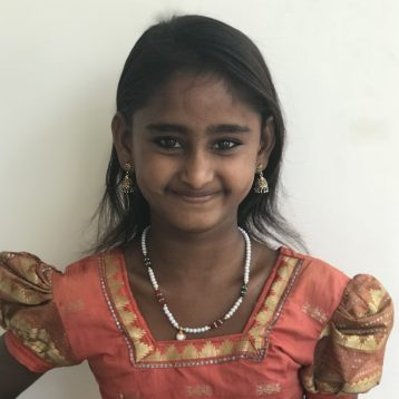 THANK YOU! Aarthi has been fully sponsored!Hi, my name is Aarthi! I was born living on the streets. It was the only life I had ever known until a team from Project I Am International started coming to visit my family. My mom used to make my four siblings and I beg during the day and then send me or my older sister to the bar to buy alcohol for her at night. My dad ran off and later the police came and told us he was murdered. Now that I am in a PIAI rescue home, I am finally able to go to school. I always dreamed of being able to read, and now I am learning. I want to be a teacher one day, but not just any teacher. I want to teach other kids that are like me so they can learn to read too. I now have hope and my dreams are coming true.