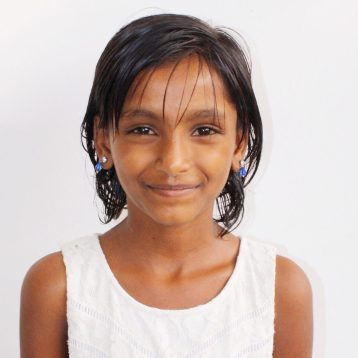 Click here to sponsor Rekha.Hi, my name is Rekah! I have lived my entire life on the streets. When I was little, I saw my dad be killed my mom's boyfriend. After my dad's death, my mother forced my siblings and me to beg on the streets for money, which she then used to by alcohol. I was rescued by Project I Am and have been living in the rescue home since then. I am very fun and loving to all my peers. I love to make people laugh. I like going to school mostly because I like seeing my friends.