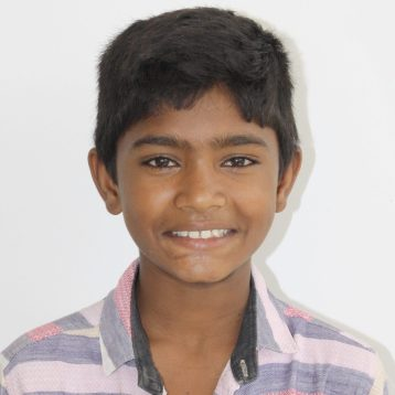 Click here to support Vishnu.Hi, my name is Vishnu! When I was a baby, my dad abandoned my family. My mother is an alcoholic, so it was up to me as the oldest brother to carry my family's financial burden and care for my younger siblings. I worked odd jobs and begged for money on the street before Project I Am found me and my younger siblings and housed us in a rescue home.